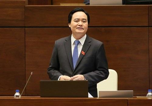 Bộ trưởng Phùng Xuân Nhạ trả lời chất vấn tại Quốc hội sáng 16/11. ảnh: Minh Quang/vietnamnet.