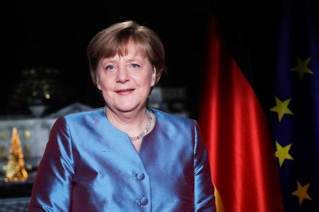 Thủ tướng Đức Angela Merkel phát biểu trên truyền trong thông điệp mừng năm mới. (Ảnh: Reuters)