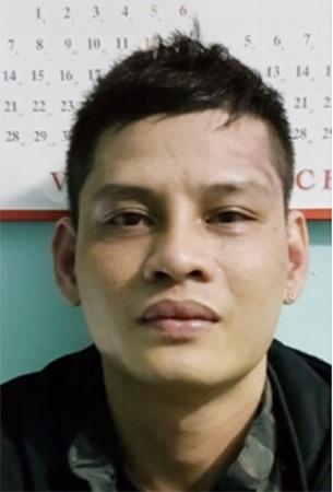 """Đối tượng Nguyễn Vinh Long (tức Long """"ma"""") tại cơ quan công an."""