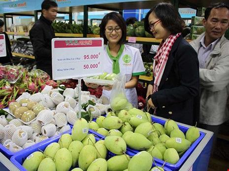 Nhiều DN đã liên kết với nông dân để sản xuất nông sản phục vụ người tiêu dùng. Ảnh: CHÂN LUẬN