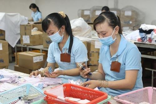 Mức thưởng Tết bình quân tại các doanh nghiệp là một tháng lương cơ bản Ảnh: KHÁNH AN