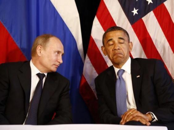 Bức ảnh chụp khoảnh khắc chạm mặt đầy miễn cưỡng giữa hai nguyên thủ quốc gia hai siêu cường thế giới tại Mexico ngày 18-6-2012.