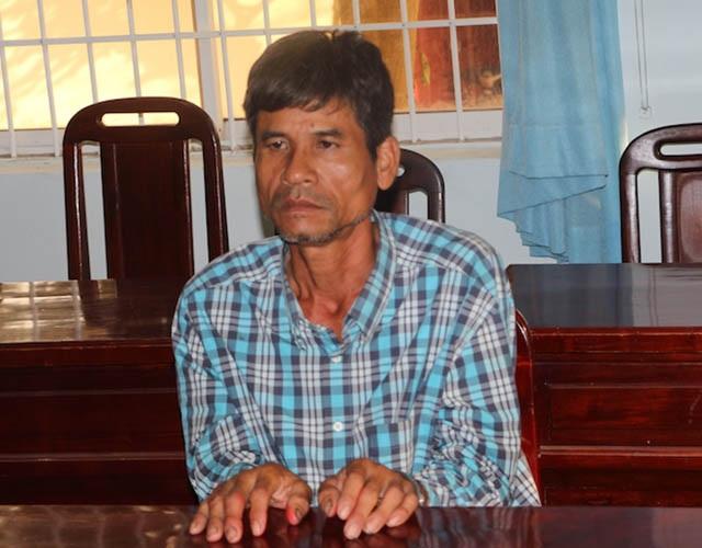 Đối tượng Kim Hoà tại cơ quan điều tra (ảnh: Bình Minh)