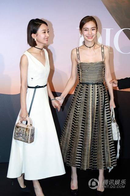 Angelababy là khách mời trong sự kiện thời trang tại Thượng Hải, Trung Quốc, tối 18/10. Nữ diễn viên khả ái diện đầm cổ điển trễ nải dù không sở hữu vòng một đầy đặn như những đồng nghiệp khác.
