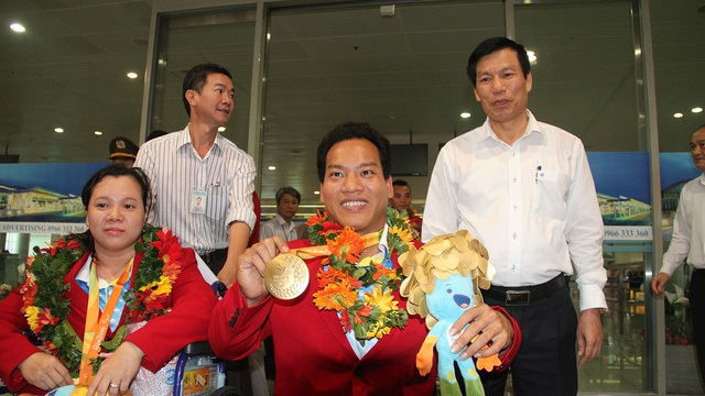 Đoàn thể thao Người khuyết tật Việt Nam về nước sau thành công tại Paralympic - 4