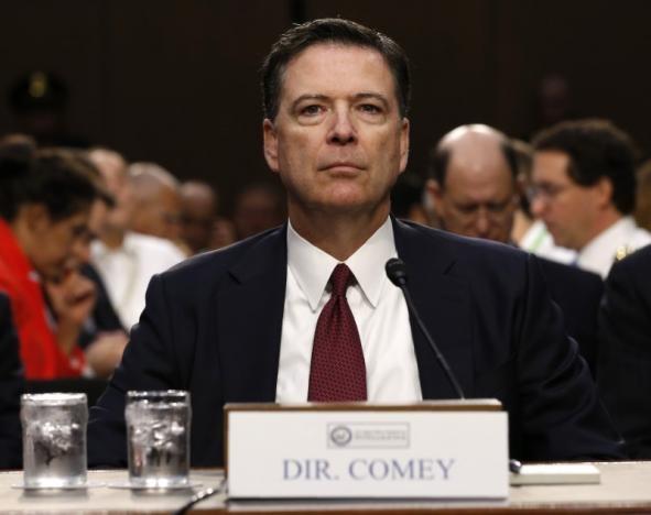 Ông Comey trong cuộc điều trần (Ảnh: Reuters)