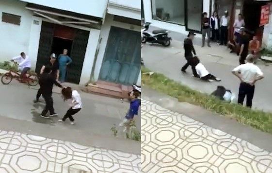 Cô gái bị túm tóc, kéo lê dưới đường. (Ảnh cắt từ clip)