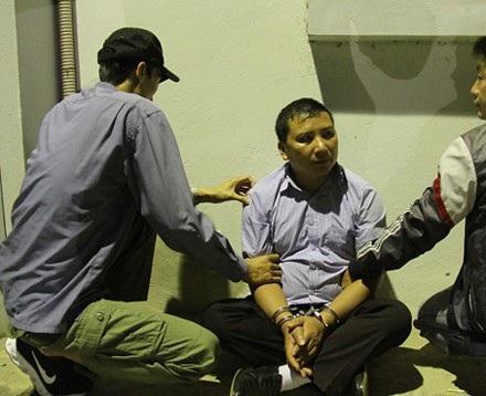 Đối tượng Lầu A Hà bị bắt giữ tại cơ quan điều tra.