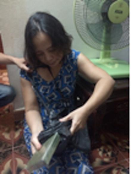 Nguyễn Thị Ngọc Lan, một trong những đối tượng chuyên buôn bán ma tuý về Thủ đô rồi xé lẻ hàng ra bán.
