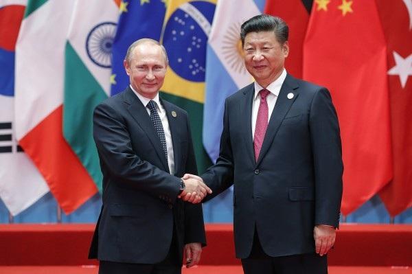 Tổng thống Nga Vladimir Putin và Chủ tịch Trung Quốc Tập Cận Bình. (Ảnh: TR)