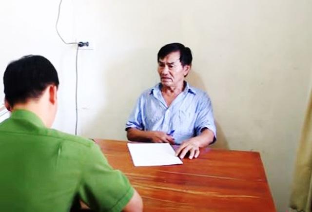 Điều tra viên lấy lời khai của bị can Nguyễn Cảnh Thắng