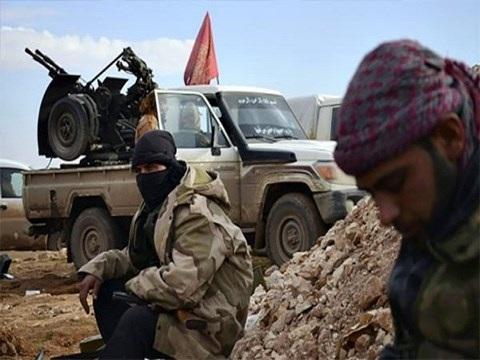 Syria: Hàng trăm phiến quân IS rời Raqqa đến Deir Ezzor - 1
