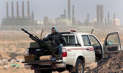 Libya tái bùng phát nội chiến, NATO phải chơi ván cờ mới? - 1