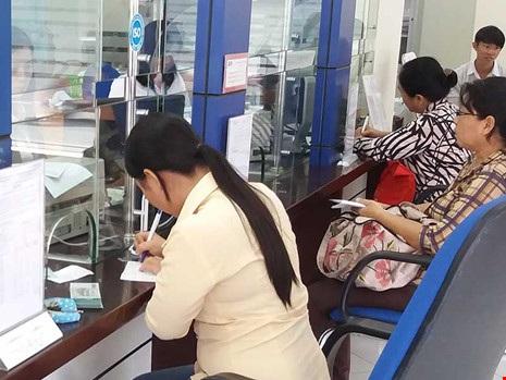 Cơ cấu lại các ngân hàng dựa trên nguyên tắc thận trọng, bảo đảm quyền lợi người gửi tiền.Ảnh minh họa: HTD