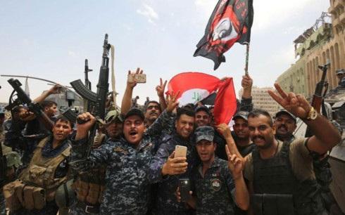 Các lực lượng Iraq vui mừng với chiến thắng ở Mosul. Ảnh: AFP.