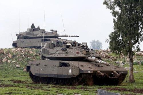 Binh lính Israel trong cuộc tập trận gần đường ngừng bắn giữa Israel và Syria tại cao nguyên Golan hồi tháng 3 Ảnh: REUTERS