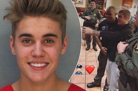 Justin Bieber vui vẻ chụp hình cùng cảnh sát