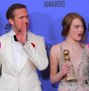 """Chẳng rõ Ryan Gosling và Emma Stone vừa nghe thấy điều gì nhưng cặp đôi phim """"La la land"""" đã kịp cống hiến cho khán giả những biểu cảm hết sức đáng yêu"""