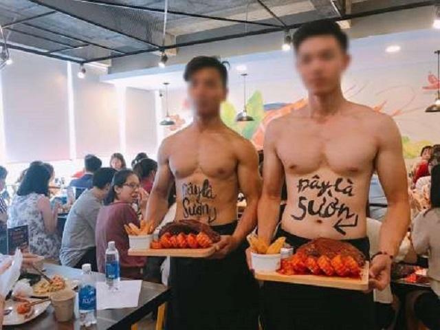 Các nam thanh niên body khủng bán nude phục vụ đồ ăn.