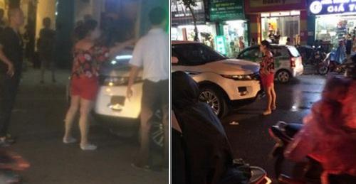 Người phụ nữ đứng chặn ngay trước chiếc xe của chồng. (Ảnh: Internet)