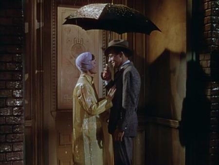 """Nụ hôn lãng mạn dưới mưa trong """"Singin in the Rain"""" (1952) của Gene Kelly và Debbie Reynolds cũng đã in sâu trong tâm trí khán giả"""