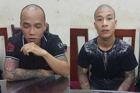 Trần Đức Anh và Trương Kim Hoàng tại Cơ quan điều tra.