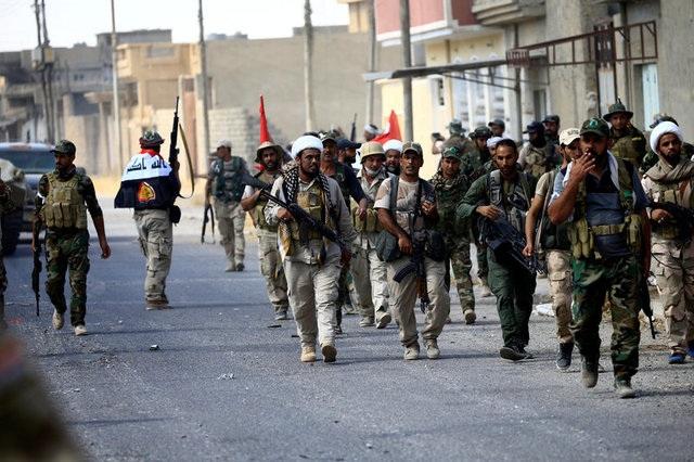 Các lực lượng Iraq trên đường phố Tal Afar (Ảnh: Reuters)