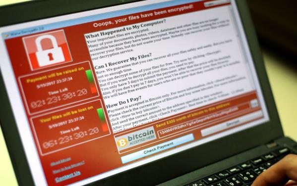Mã độc WannaCry từng tấn công 300.000 máy tính tại 150 quốc gia trên thế giới (Ảnh: EPA)