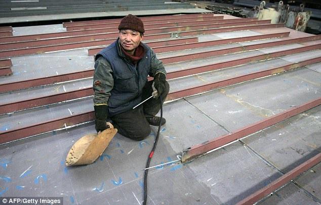 Một người Triều Tiên làm việc tại Ba Lan trong một bức ảnh năm 2006 (Ảnh: AFP/Getty)