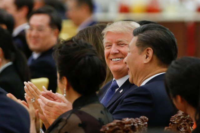 Chủ tịch Tập Cận Bình sáng nay đã chủ trì lễ đón chính thức Tổng thống Trump tại Đại lễ đường Nhân dân Trung Quốc với nhiều nghi thức trang trọng như bắn đại bác và trải thảm đỏ. (Ảnh: Reuters)