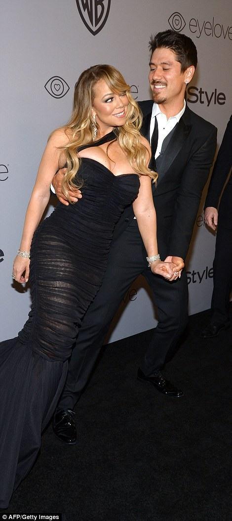 Mariah Carey điệu đà dự vào bạn trai Bryan Tanaka khi dự tiệc mừng thành công của lễ trao giải Quả Cầu Vàng 2018 tổ chức tại Beverly Hills, California, Mỹ ngày 8/1 vừa qua