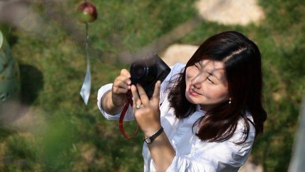 Huan Yan, một cô gái trẻ có niềm đam mê với chụp ảnh ...