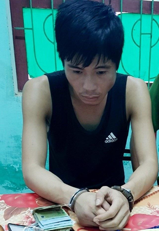 Đối tượng Lê Văn Trung bị bắt giữ. (Ảnh T.T)