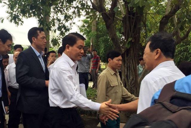 Ông Nguyễn Đức Chung - Chủ tịch UBND TP Hà Nội trong lần về đối thoại với nhân dân xã Đồng Tâm (huyện Mỹ Đức).