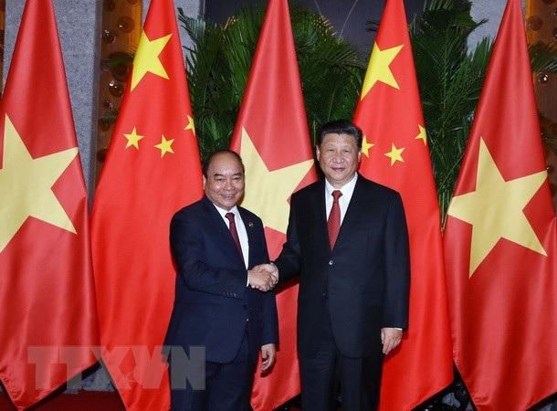 Thủ tướng Nguyễn Xuân Phúc và Chủ tịch Trung Quốc Tập Cận Bình tại Thượng Hải, Trung Quốc ngày 4/11 (ảnh: TTXVN)