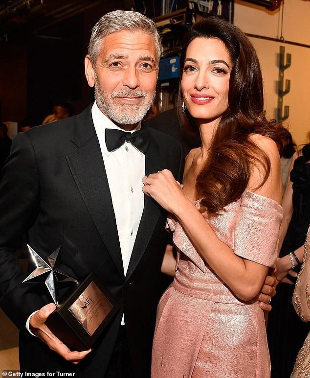 George Clooney bên vợ - nữ luật sư Amal Clooney