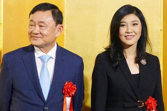 Bà Yingluck và ông Thaksin tham gia sự kiện giới thiệu sách ở Nhật Bản hôm 29-3. Ảnh: Kyodo News
