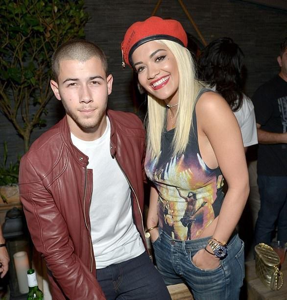 Nick bên bạn gái tin đồn Rita Ora