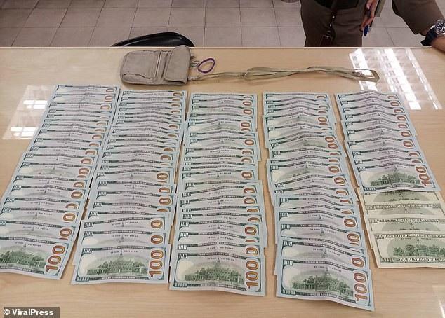 Số tiền mặt du khách Mỹ bỏ quên trong chiếc túi được hoàn trả đầy đủ