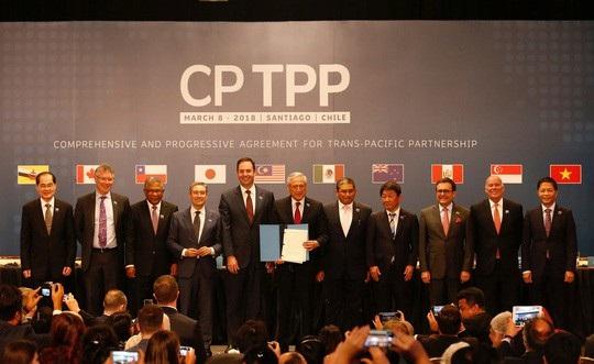 Các thành viên TPP-11 chụp hình tập thể sau lễ ký kết CPTPP. Ảnh: Reuters.