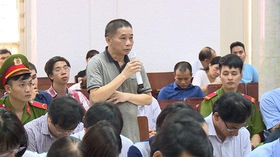 Bị can Ninh Văn Quỳnh và gia đình đã khắc phục 20 tỷ đồng- tiền chiếm đoạt do hành vi phạm tội mà có (Ảnh: TTXVN).