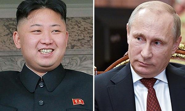 Tổng thống Nga Vladimir Putin (phải) và nhà lãnh đạo Triều Tiên Kim Jong-un (Ảnh: PA)