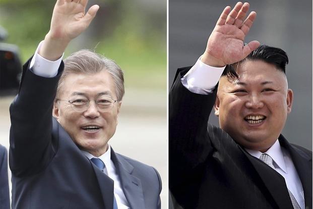 Tổng thống Hàn Quốc Moon Jae-in (trái) và nhà lãnh đạo Triều Tiên Kim Jong-un (Ảnh: Getty)