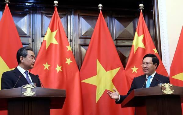 Phó Thủ tướng, Bộ trưởng Ngoại giao Việt Nam Phạm Bình Minh và Bộ trưởng Ngoại giao Trung Quốc Vương Nghị