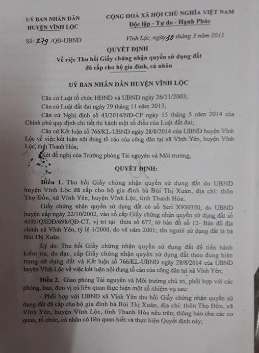 Quyết định của UBND huyện Vĩnh Lộc về việc thu hồi GCNQSD đất của hai gia đình.