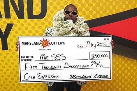 Quý ông SSS bên giải thưởng 50.000 USD.