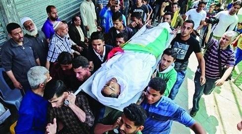 Một trẻ em Palestine thiệt mạng trong cuộc biểu tình ở Gaza. (ảnh: AFP)