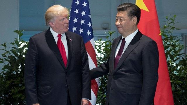 Tổng thống Mỹ Donald Trump (trái) và Chủ tịch Trung Quốc Tập Cận Bình (Ảnh: Reuters)