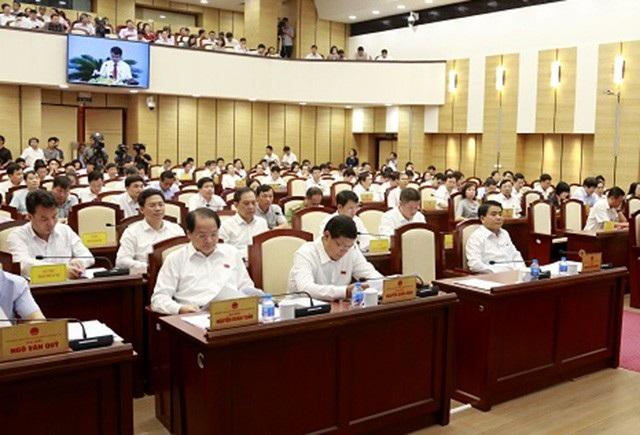 Các đại biểu dự phiên giải trình về tình hình quản lý các dự án vốn ngoài ngân sách có sử dụng đất chậm triển khai, vi phạm Luật Đất đai trên địa bàn TP Hà Nội.