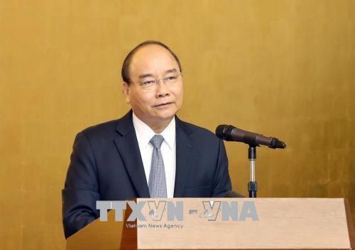 Thủ tướng Nguyễn Xuân Phúc phát biểu tại buổi gặp mặt. Ảnh: Thống Nhất/TTXVN